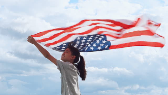 Happy asian little girl with American flag USA celebrate 4th of July Happy asian little girl with American flag USA celebrate 4th of July family 4th of july videos stock videos & royalty-free footage