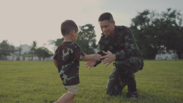 Happy asian soldier reunited with his family video