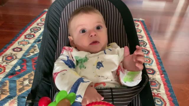 happy baby adorable cute infant feeling joy - 0 11 mesi video stock e b–roll