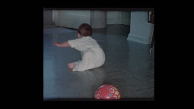 happy baby boy crawling around slippery tile floor - hotel reception filmów i materiałów b-roll