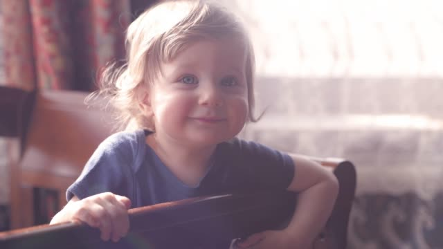 happy baby boy indoors - neonati maschi video stock e b–roll