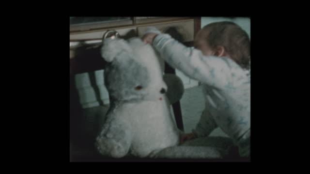vídeos de stock e filmes b-roll de happy baby boy plays with stuffed teddy bear - teddy bear
