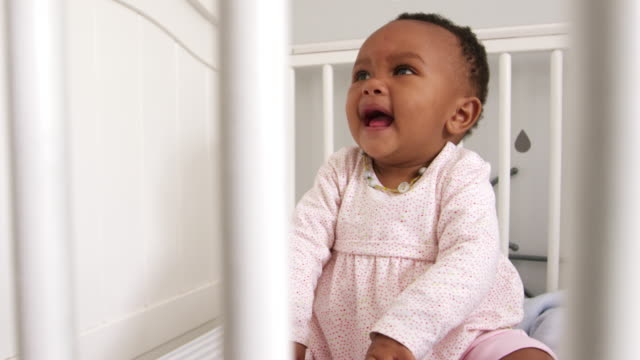 Happy Baby Girl Playing In Nursery Cot Shot In Slow Motion video