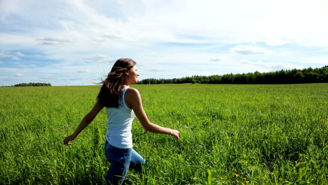 Happy Beautiful Woman Goes on a Grass in the Field video