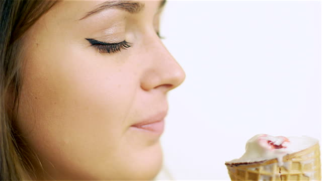 happy beautiful young girl eating ice cream