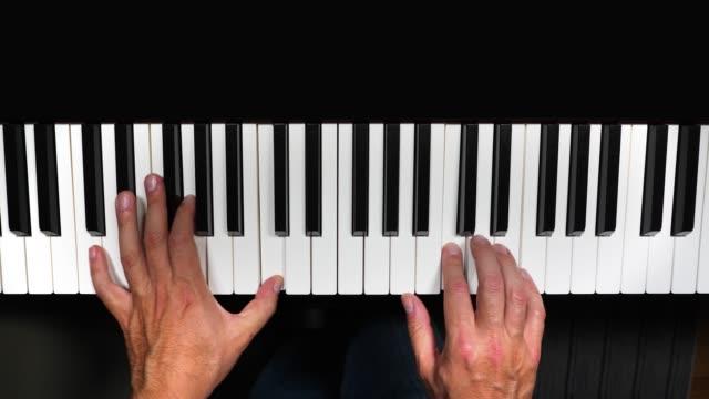 vídeos de stock e filmes b-roll de happy birthday played on piano keyboard - piano
