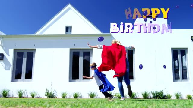 grattis på födelsedagen skriven över mor och son i bakgrunden - moods vector boy bildbanksvideor och videomaterial från bakom kulisserna