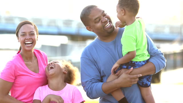 Happy black family with two children outdoors video