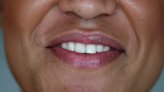 Happy black woman mouth talking to camera