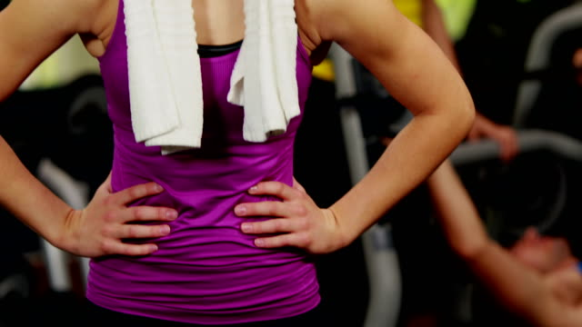 Happy blonde woman smiling to camera Happy blonde woman smiling to camera at gym arms akimbo stock videos & royalty-free footage