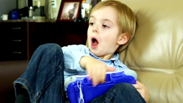 Happy Boy Using Digital Tablet video