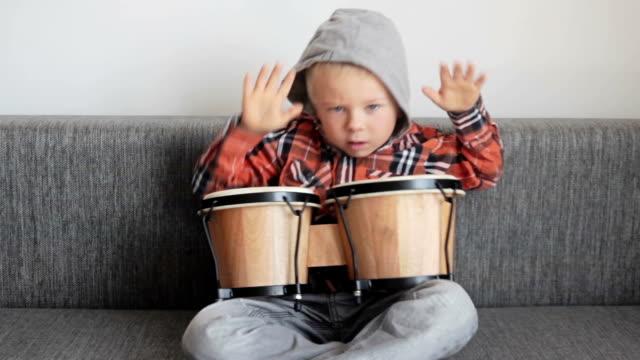Happy boy with bongos video