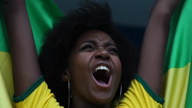 Happy Brazilian fan celebrating in a soccer game Happy Brazilian fan match sport stock videos & royalty-free footage