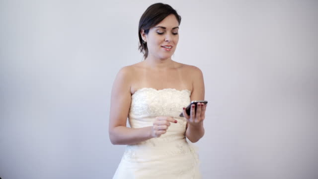 Happy bride to be making a call on her cellphone video