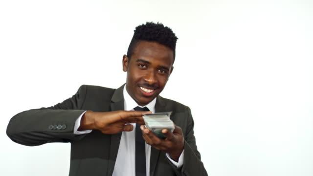 happy businessman throwing money - dollar bill стоковые видео и кадры b-roll