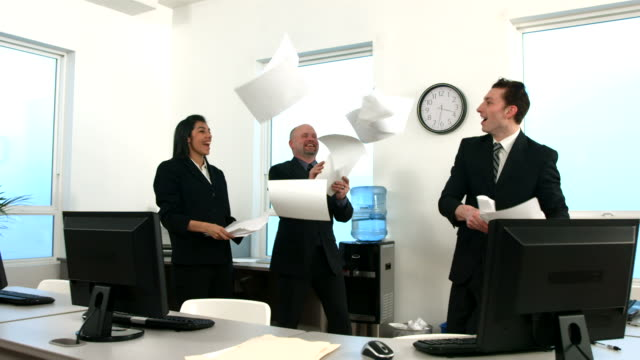 Happy businesspeople throwing papers video