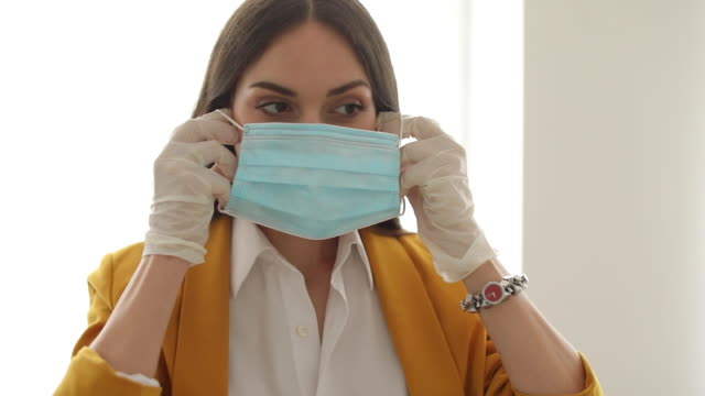 happy businesswoman with protective face mask and surgical gloves - new normal video stock e b–roll