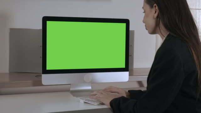 happy businesswoman working on pc video