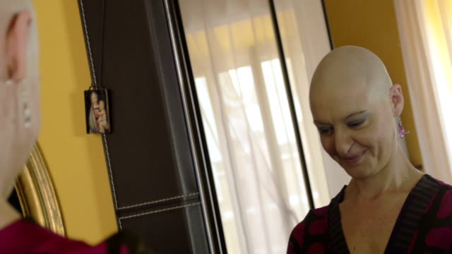 Happy cancer survivor after successful chemotherapy wearing the wig: hope, life video