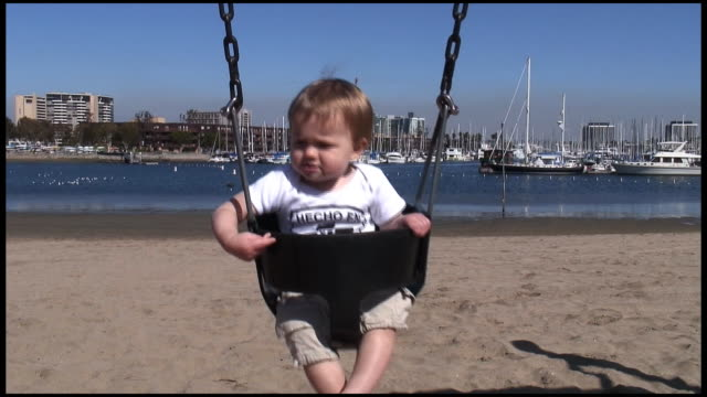 (HD1080) Happy, Carefree Chubby Baby, Toddler Swings, Plays on Beach video