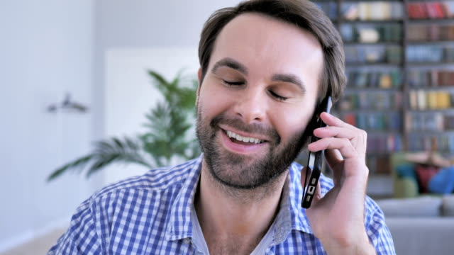 Happy Casual Beard Man Talking on Phone and Sharing His Opinion ,4k , high quality video