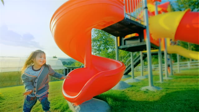 Happy Child Playing On A Slide At The Playground video