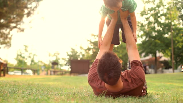 Happy child playing with dad at the park  horticulture stock videos & royalty-free footage