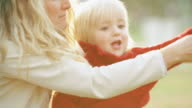 istock Happy child playing with the mother at park 151797328