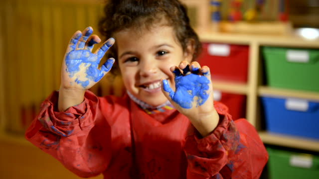 Happy children having fun and painting with hands in kindergarten Kids, school and education, happy children having fun and painting with hands in kindergarten. Sequence. child care stock videos & royalty-free footage