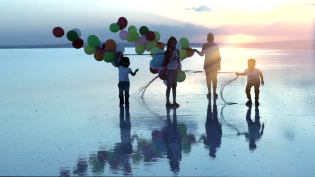 Happy children jumping on the water with color balloons video