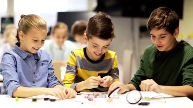 happy children learning at robotics school video