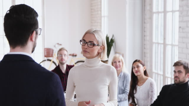 Happy confident young businesswoman get promoted handshaking boss Happy confident young businesswoman get promoted handshaking male boss appreciating best female worker for good work result while team clap hands give positive feedback and staff incentive concept promotion employment stock videos & royalty-free footage