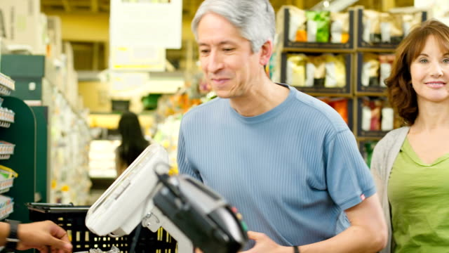 happy couple buy groceries - baby boomer stock videos and b-roll footage