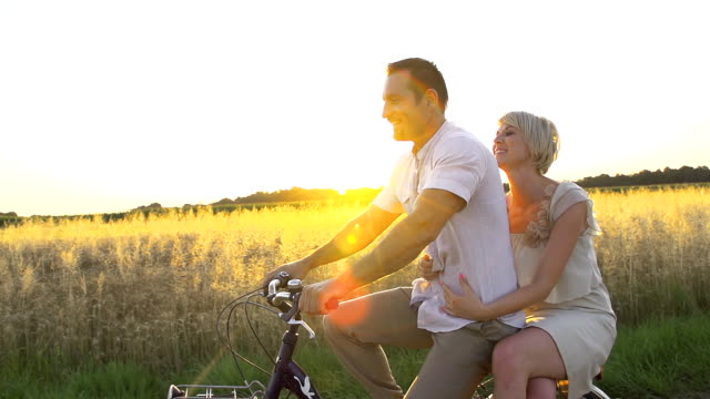 HD SUPER SLOW MO: Happy Couple Cycling In Countryside video