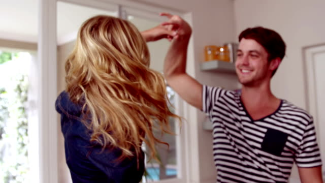 Happy couple dancing in the kitchen video