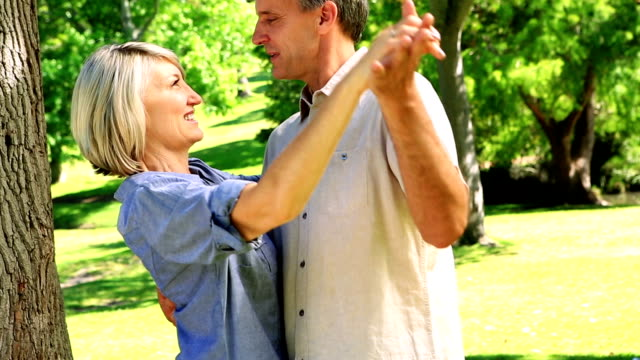 Happy couple dancing in the park video
