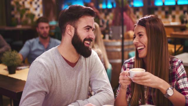 Happy couple enjoying sitting in cafe