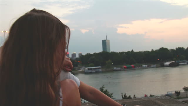 happy couple enjoying urban scenery in sunset / sunrise time. - белград стоковые видео и кадры b-roll