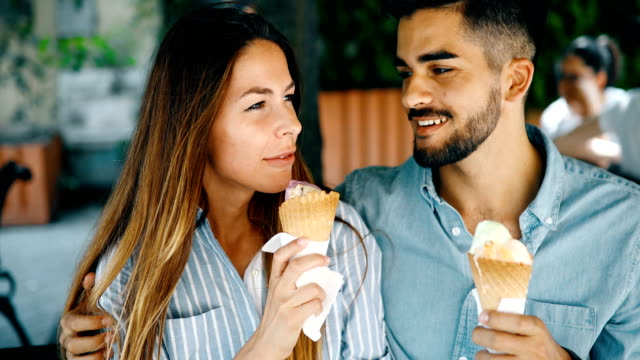 Happy couple having date and eating ice cream video