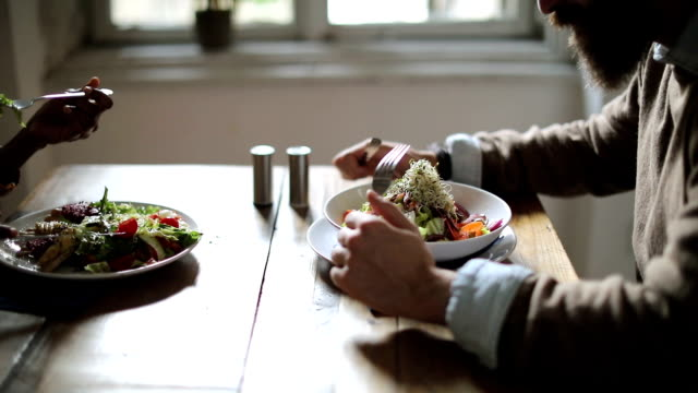 Happy couple having healthy dinner video