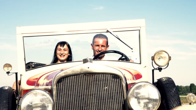 HD SUPER SLOW-MOTION: Happy Couple In A Vintage Convertible Car