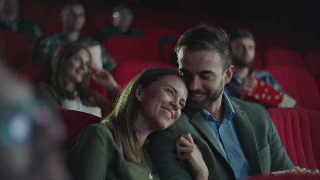 Happy couple in cinema video