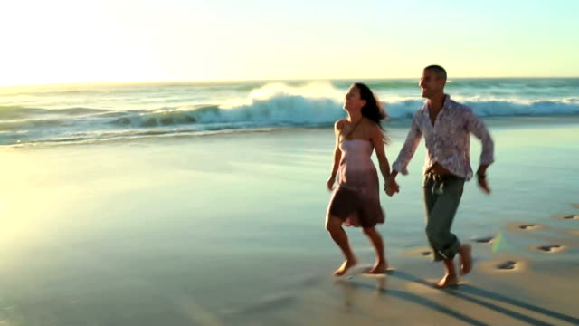 Happy couple in love on the beach video