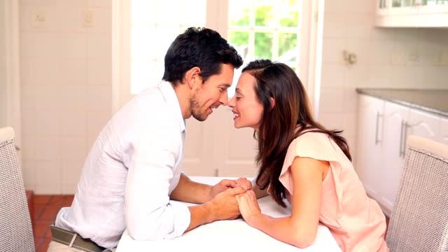 happy couple kissing at the table - 30 39 år bildbanksvideor och videomaterial från bakom kulisserna