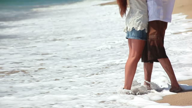 Happy couple kissing on beach. video