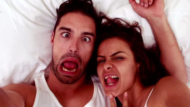 Happy couple making grimaces video