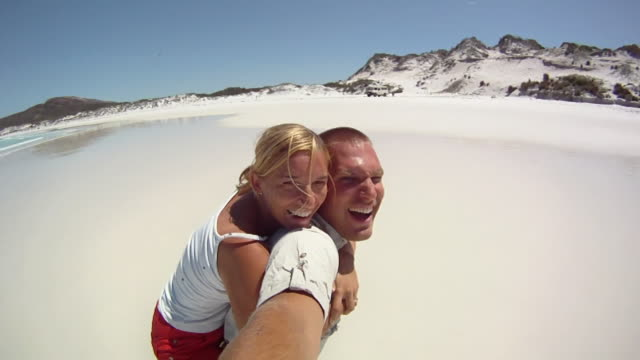 hd slow-motion: happy couple on the beach - western australia stock videos & royalty-free footage
