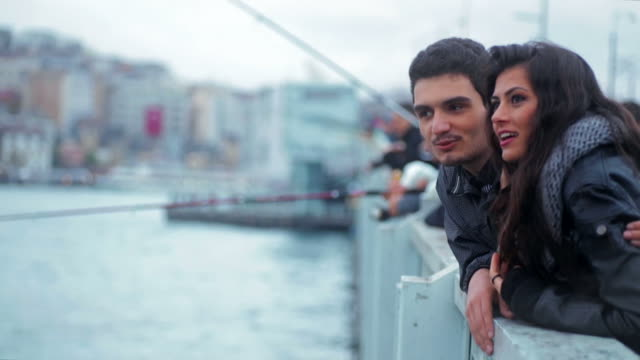 Happy couple on the Galata Bridge in Istanbul video