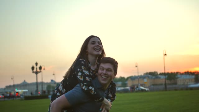 Happy couple playing in the summer field