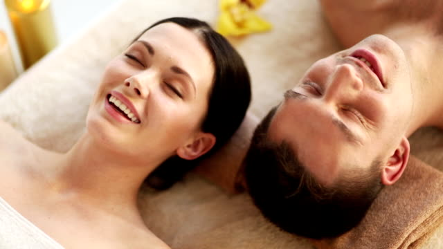 happy couple relaxing in spa salon footage of happy couple relaxing in spa salon spa treatment stock videos & royalty-free footage